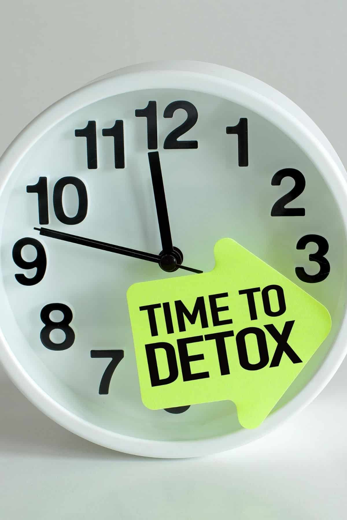 clock with a note that says time to detox on it