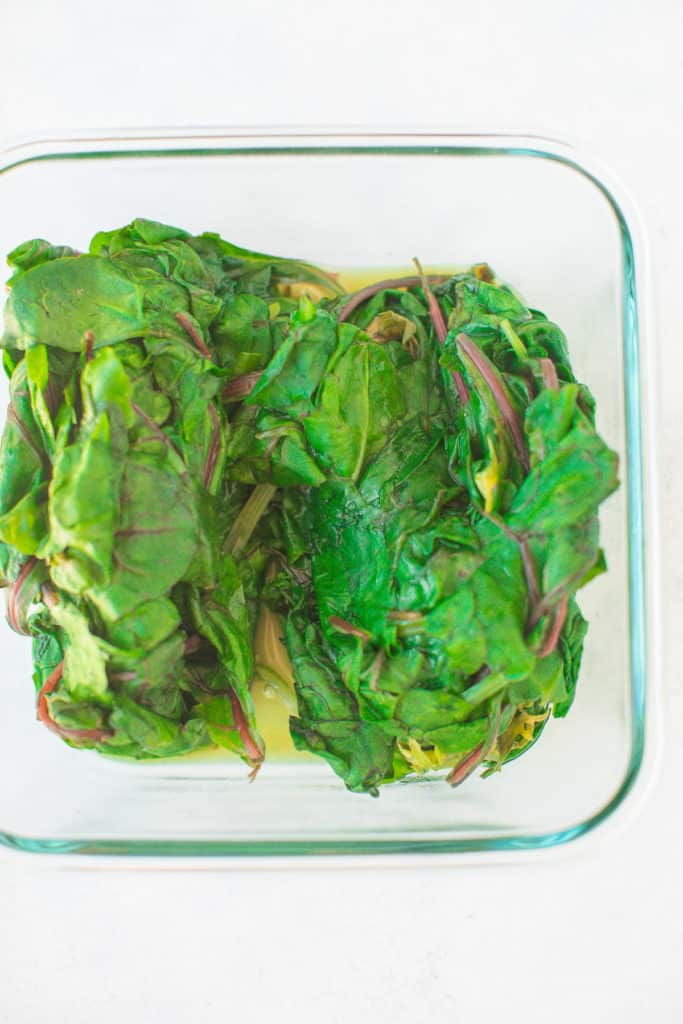 steamed greens in a glass container