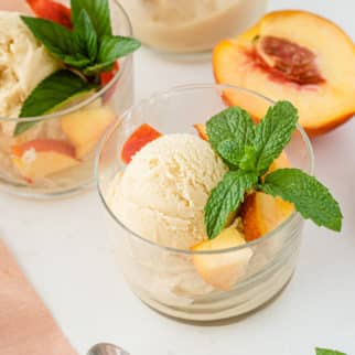two bowls of dairy free peach ice cream