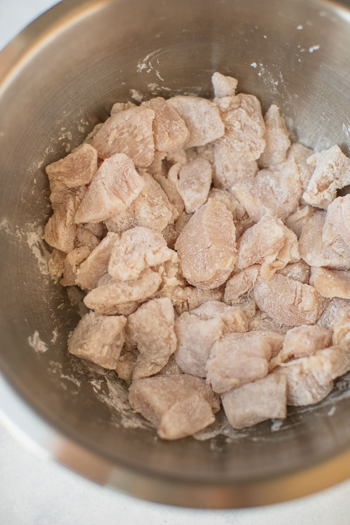 chicken and starch in a mixing bowl