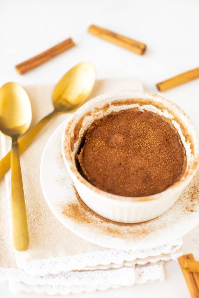 snickerdoodle mug cake with cinnamon sticks