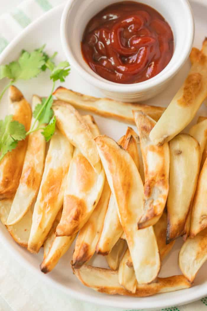 platter of baked french fries with ketchup