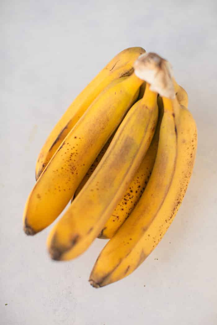 bunch of ripe bananas on a white background