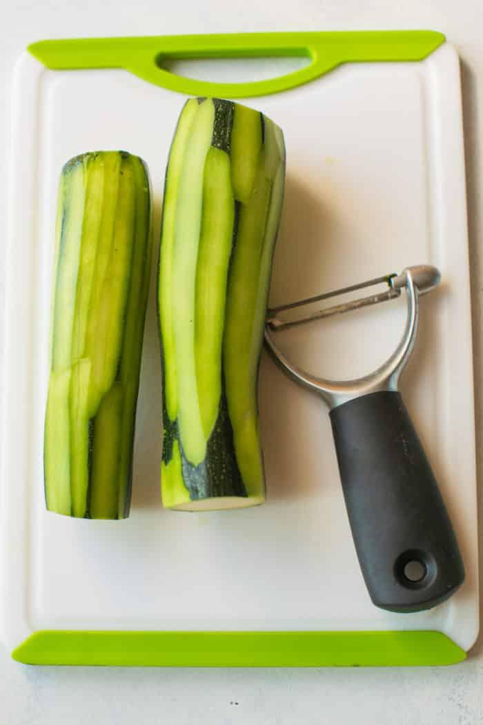 peeled zucchini on a cutting board