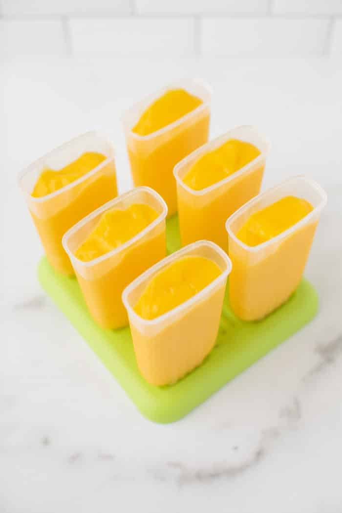 mango mixture in popsicle molds