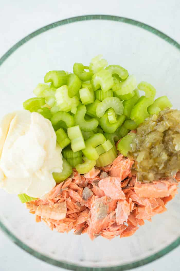salmon salad ingredients in a mixing bowl