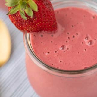 pink smoothie with a fresh strawberry