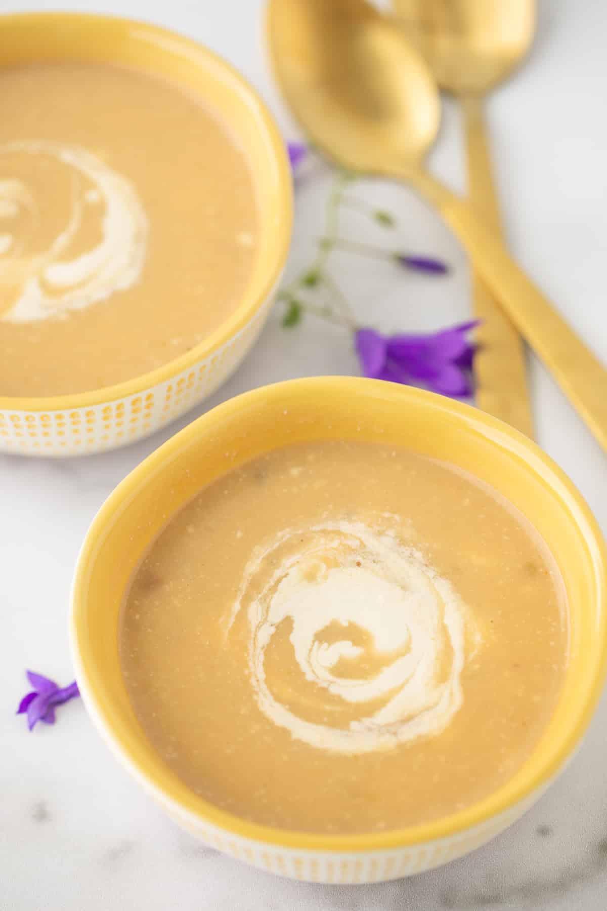 bowl of zucchini potato soup with cashew cream swirl
