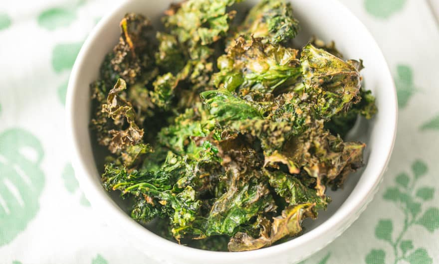 kale chips in a white bowl ready to be eaten