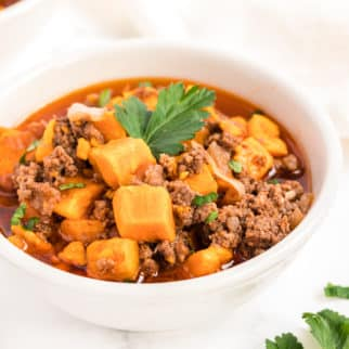 instant pot sweet potato and beef chili served in a white bowl
