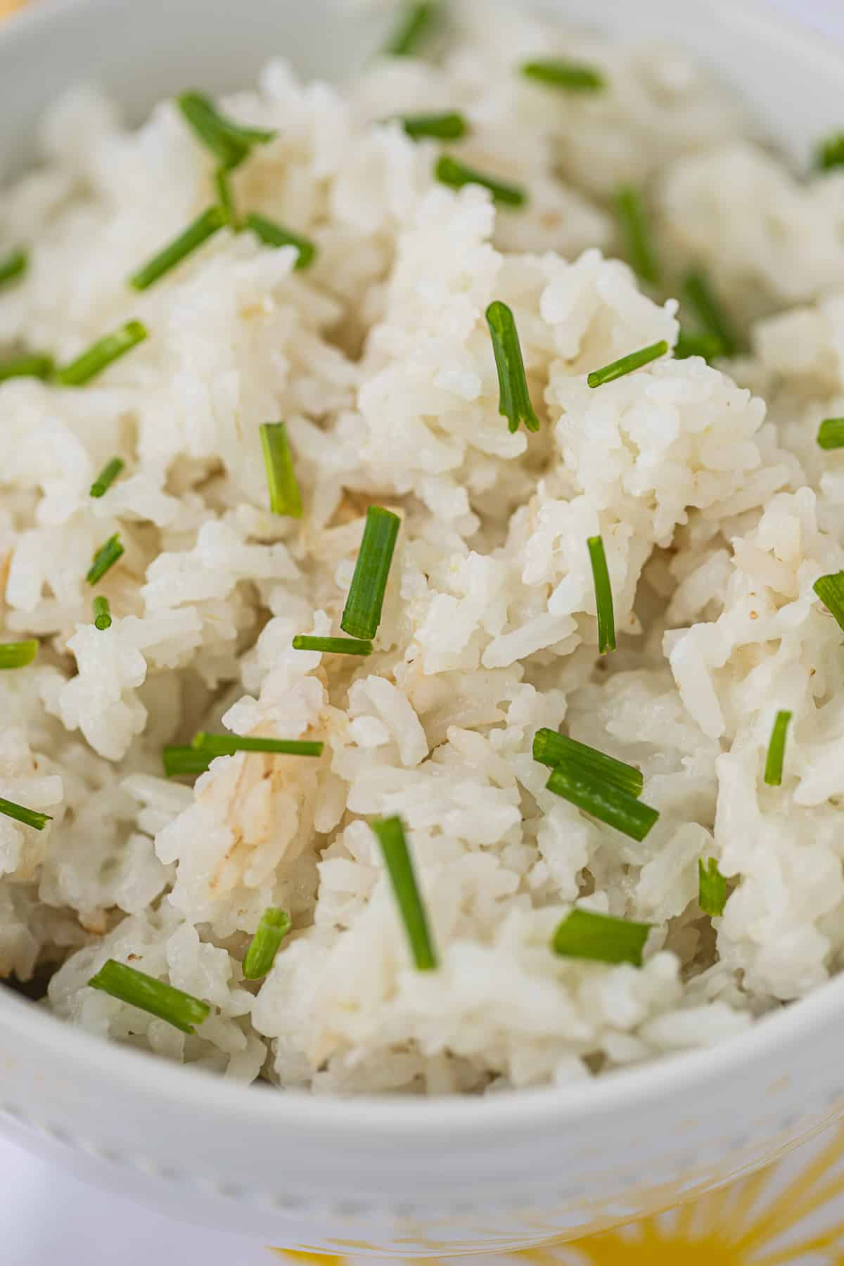 picture of coconut rice up close with bits of chopped chives