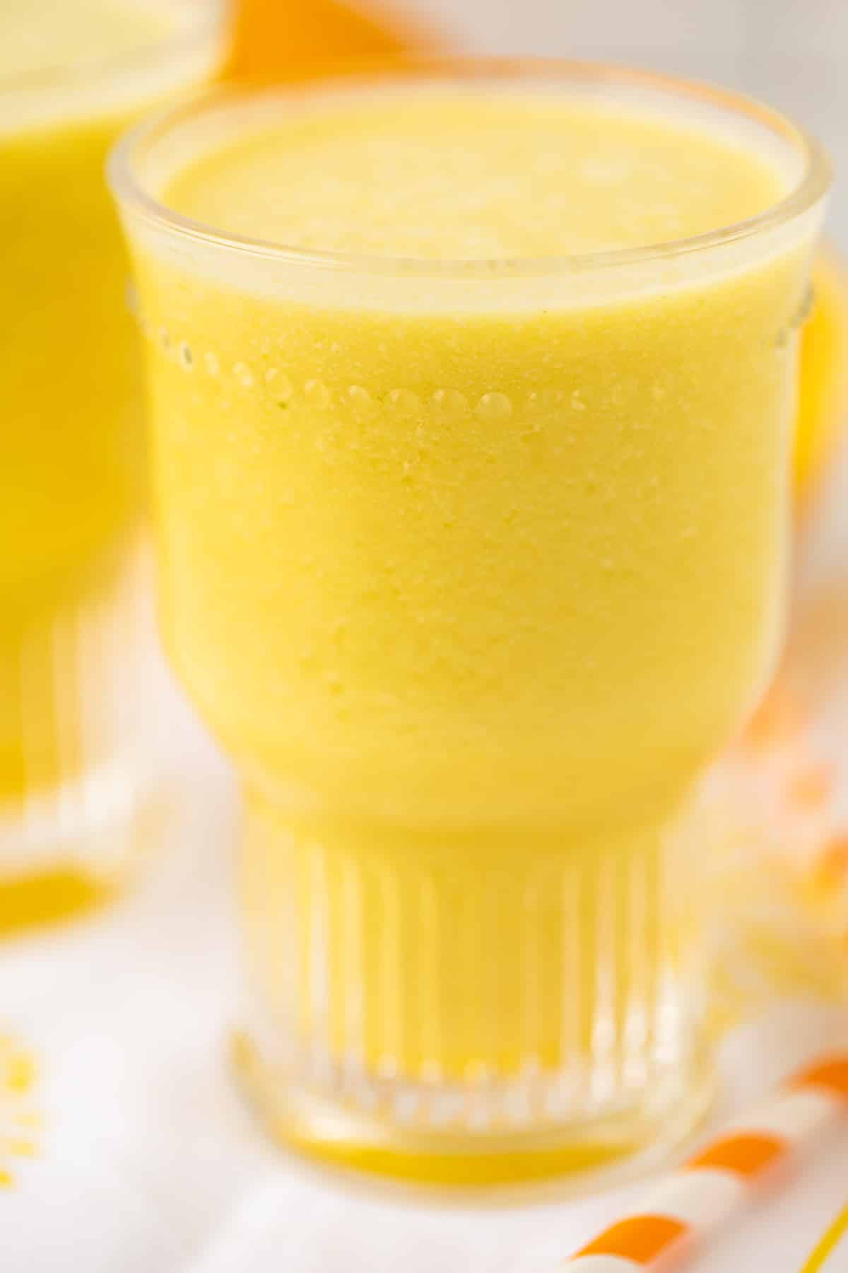 glass of yellow smoothie
