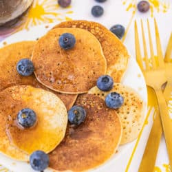 plate of pancakes with gold forks