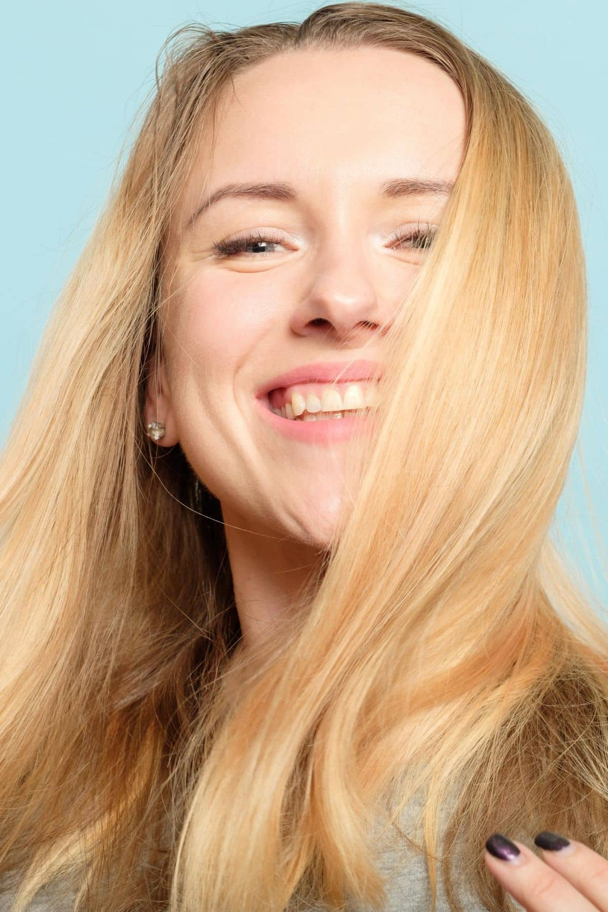 woman with long blond hair smiling at the camera