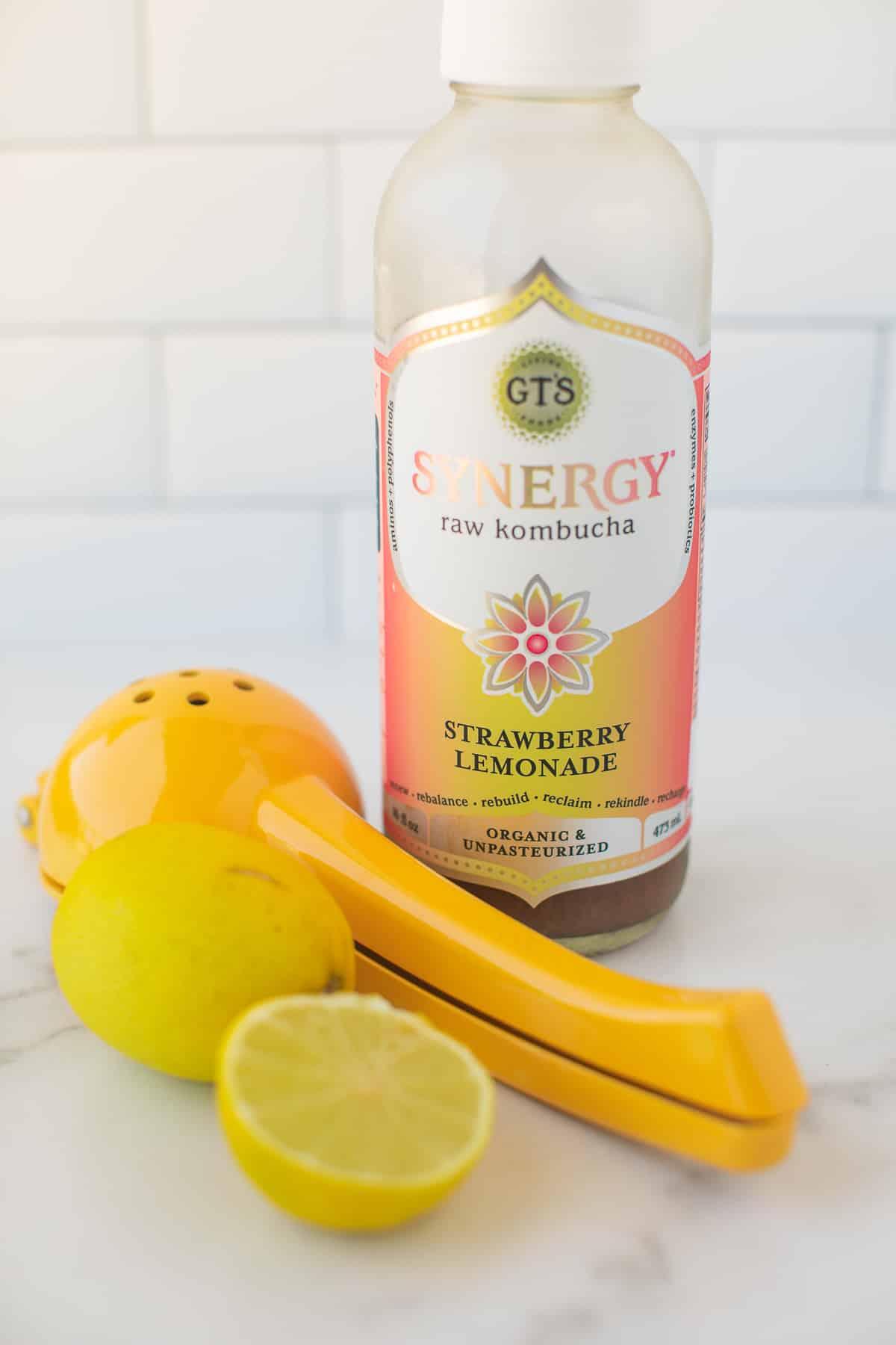 bottled kombucha with fresh lemon juice