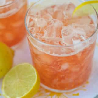 two glasses of sparkling pink lemonade with lemon