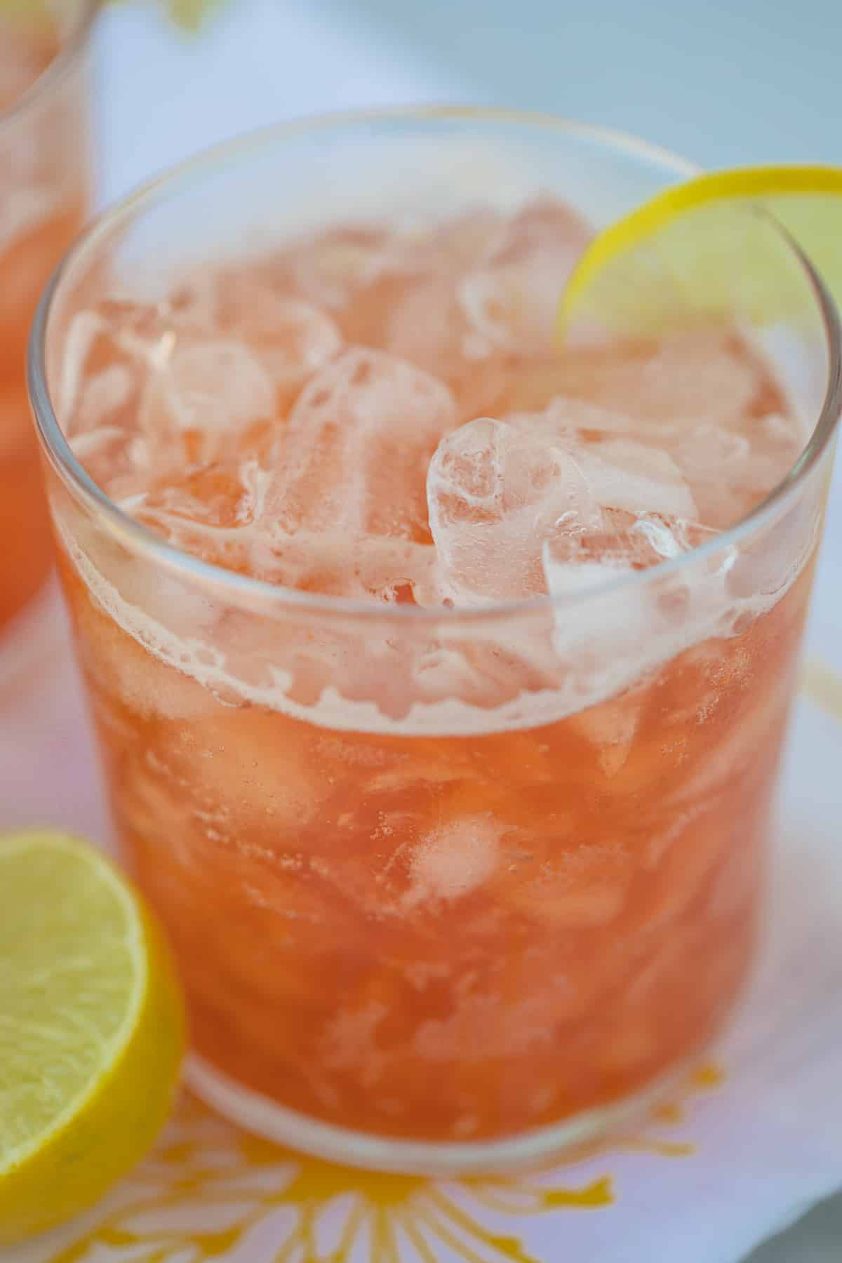 glass of sparkling pink lemonade with ice