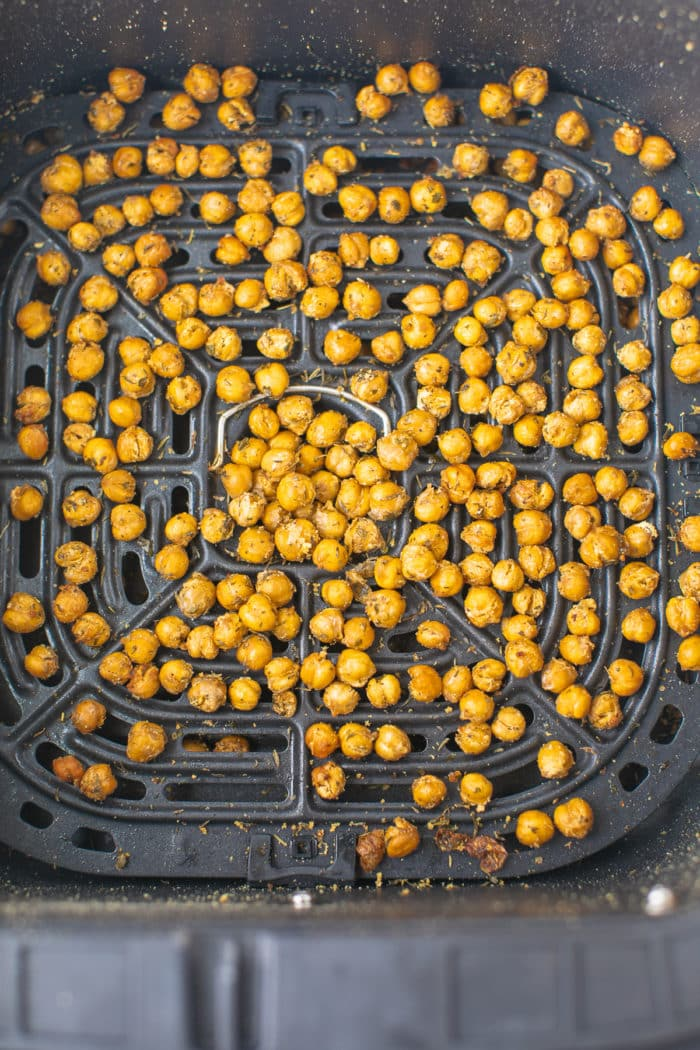 roasted chickpeas in the basket of an air fryer