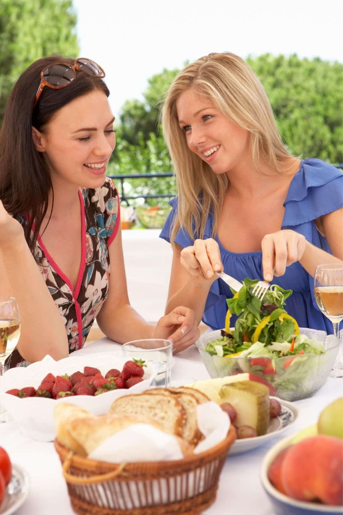 two women eating a salad