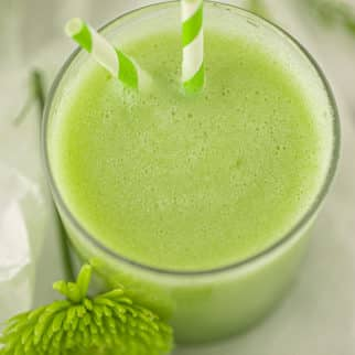 overhead image of the green honeydew smoothie in a serving glass