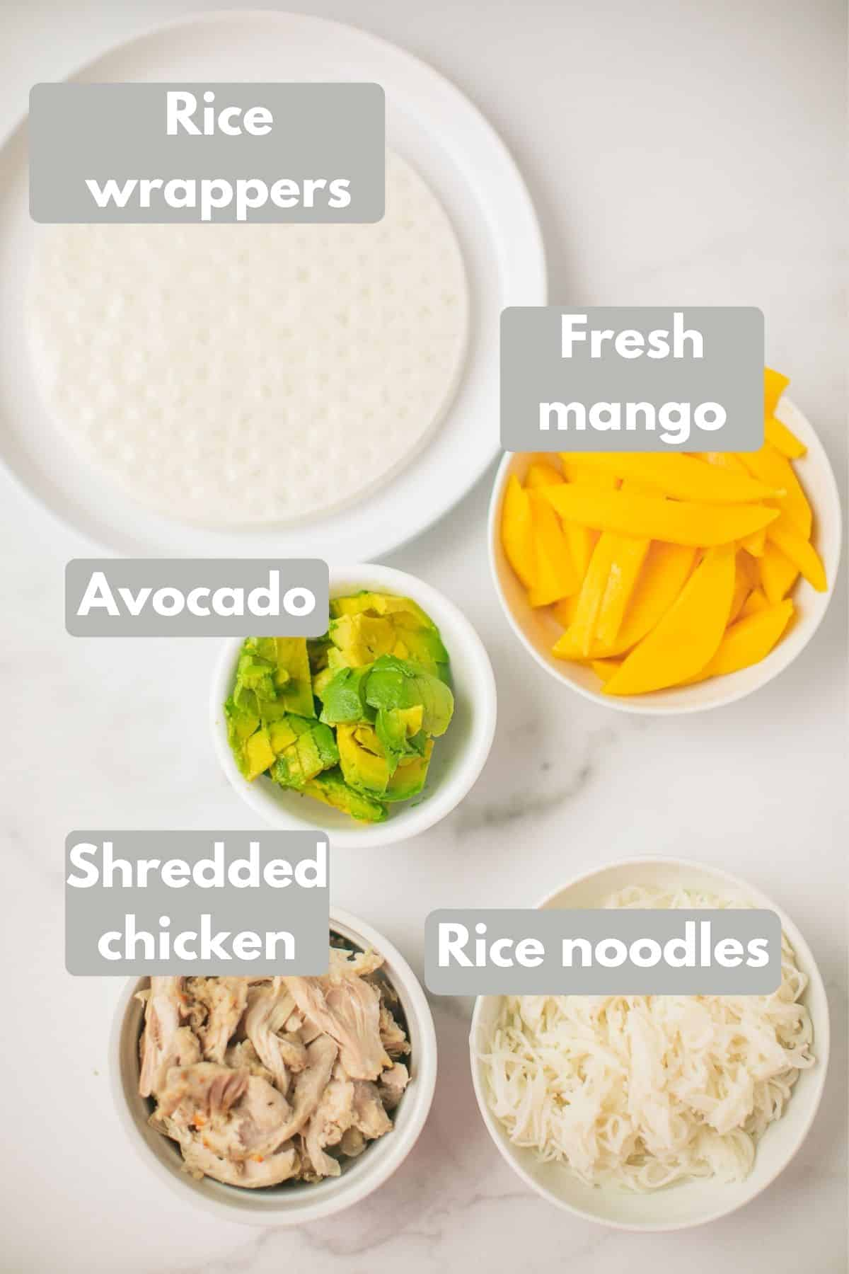 labeled ingredients for mango chicken summer rolls recipe
