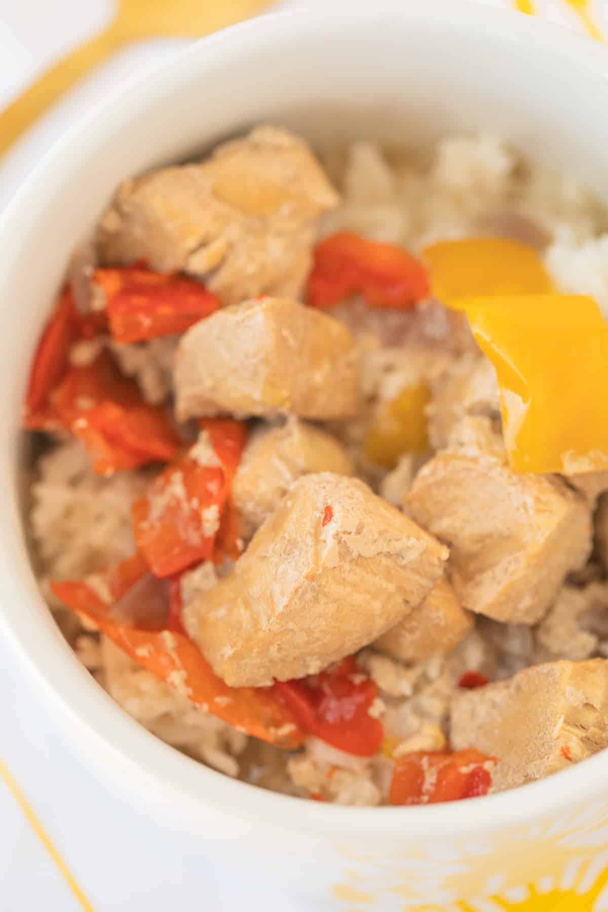 instant pot fish stew served in a bowl over cooked rice