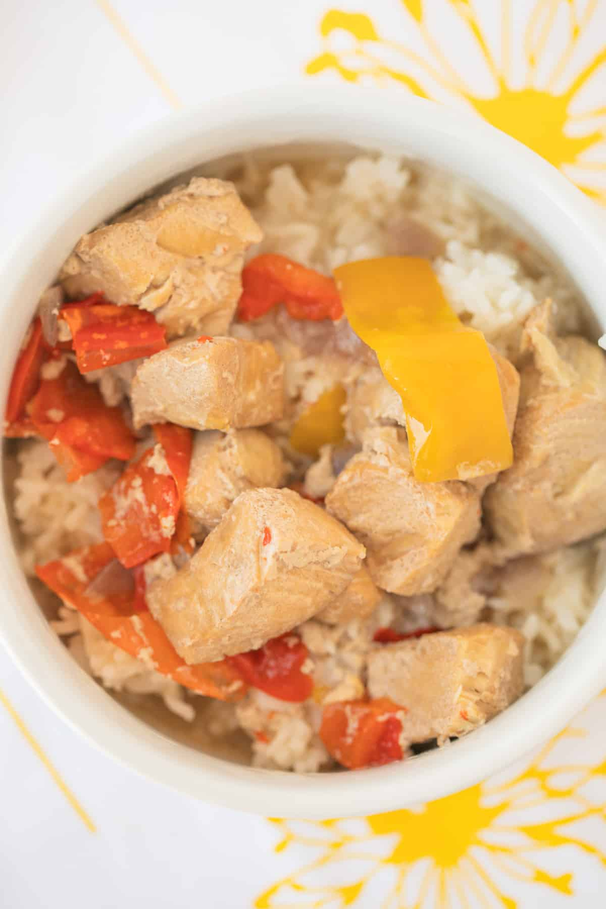 bowl of coconut fish stew served over white rice