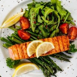 cooked salmon on a bed of steamed greens