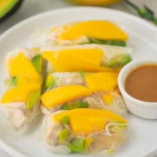 white plate filled with mango summer rolls