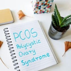 notebook with PCOS written in blue letters