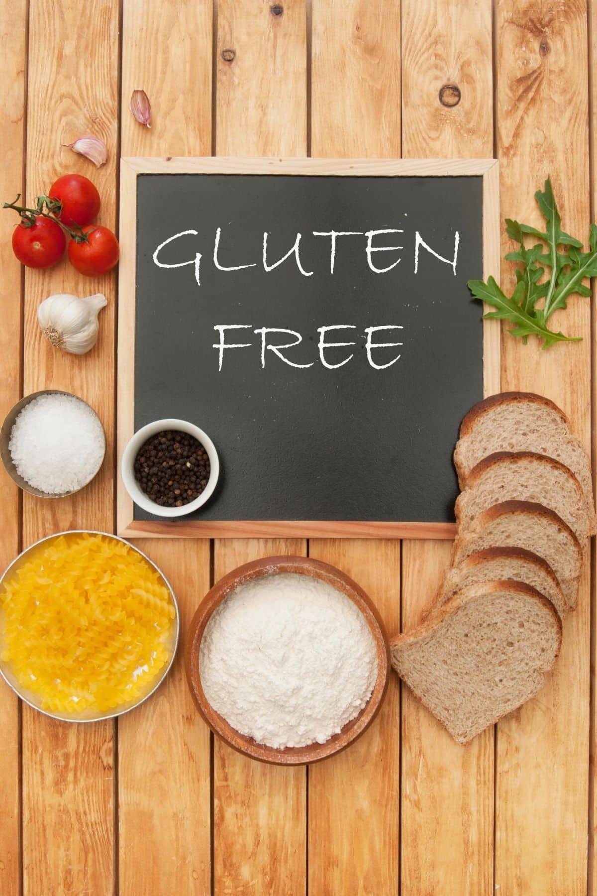 blackboard on a table with gluten free written on it
