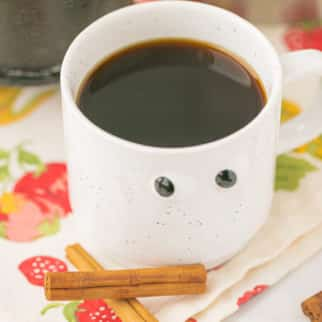 coffee in a mug with goggly eyes