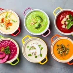 six difference soup recipes in colored bowls