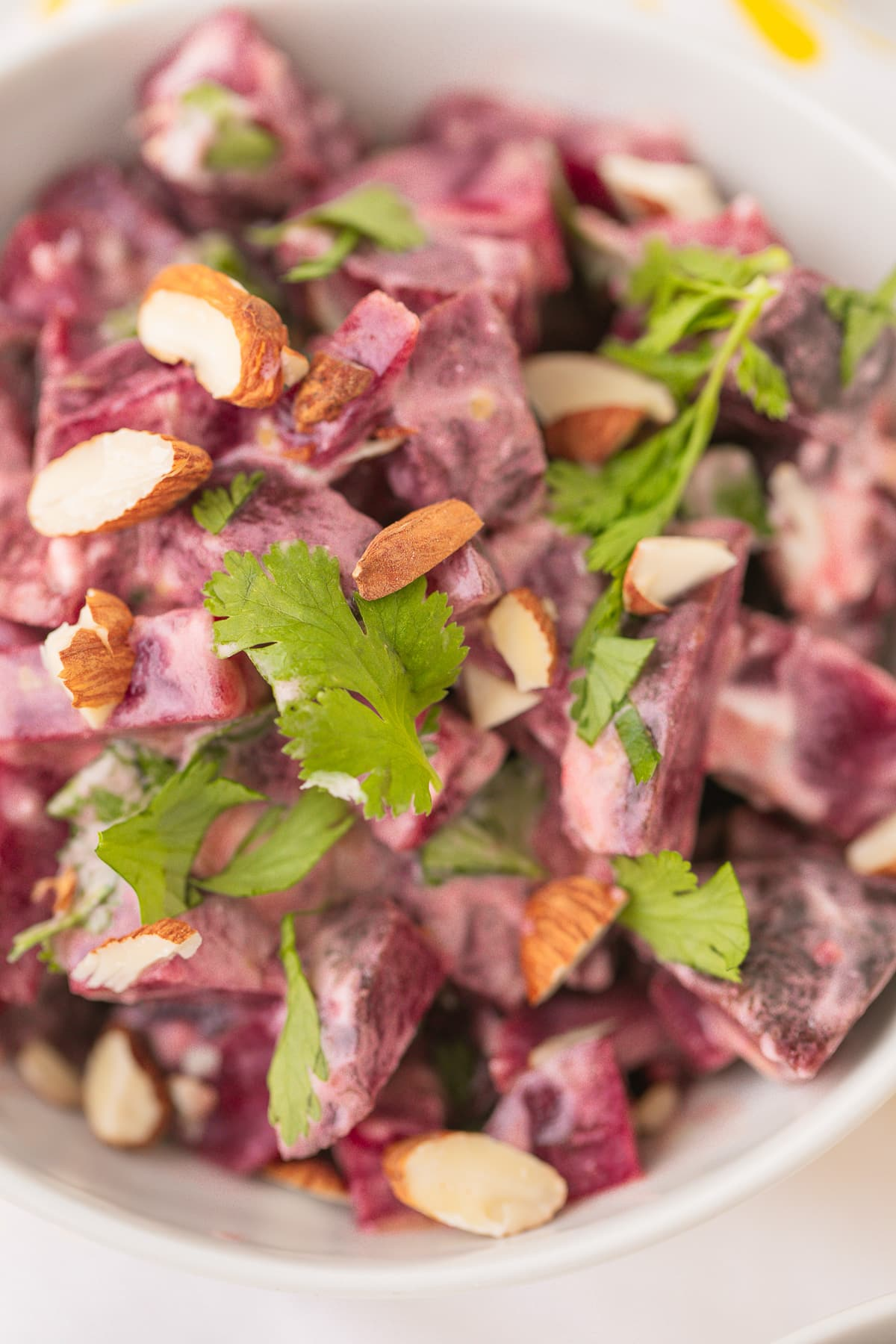 tossed beet salad with chopped cilantro on top