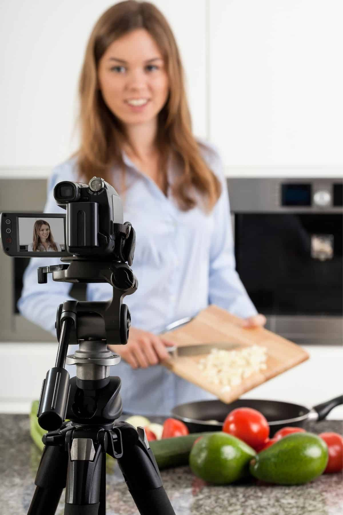 woman cooking in front of a camera