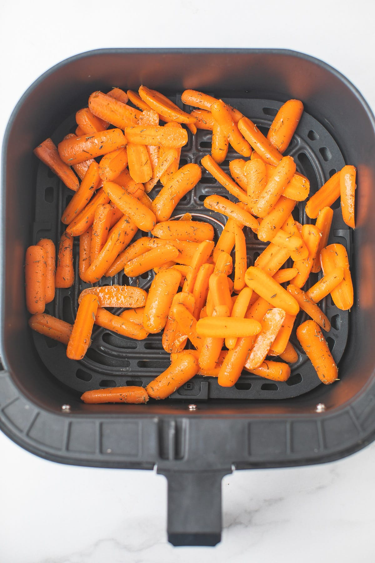 carrots cooking in an air fryer
