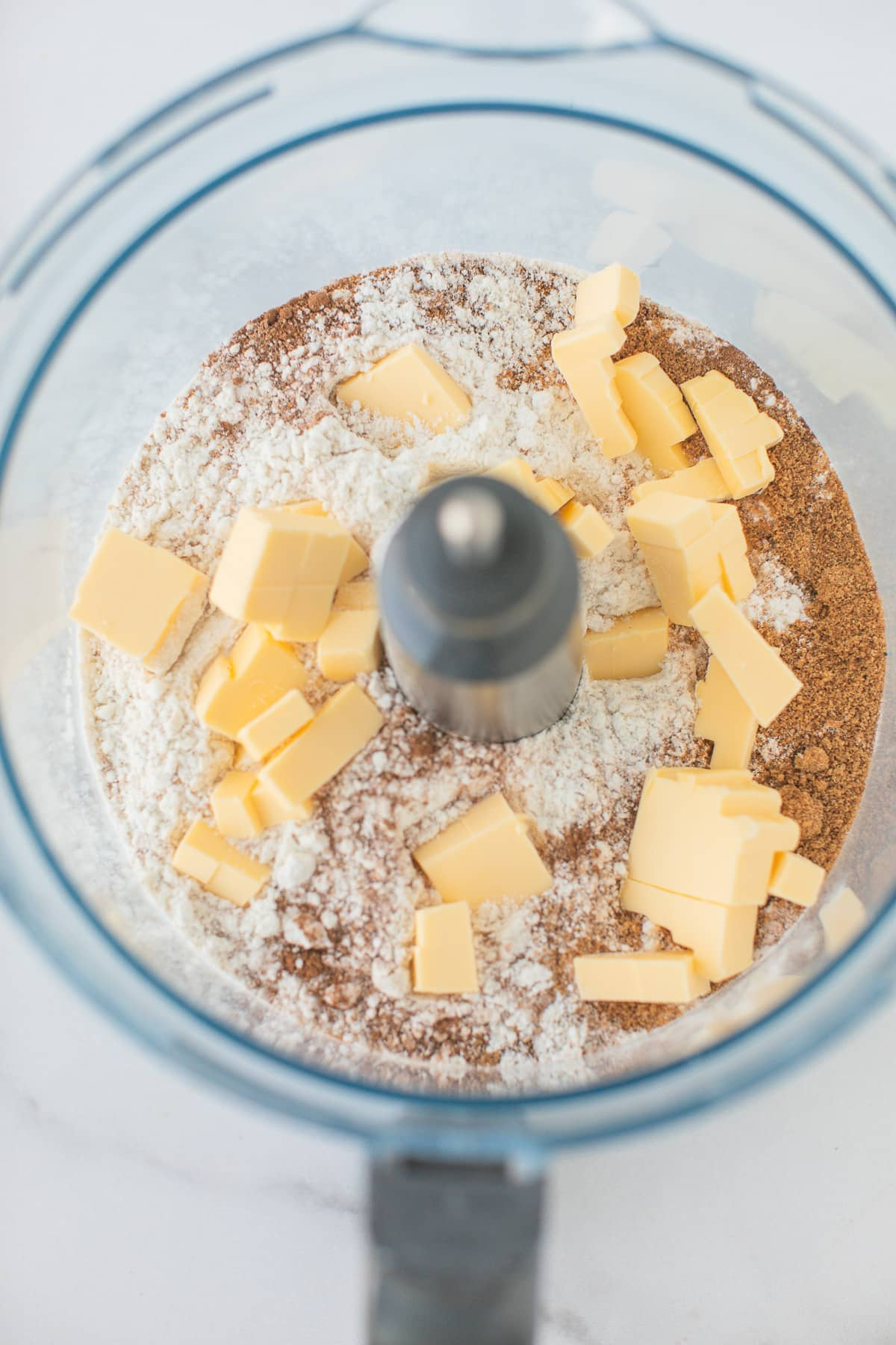 food processor bowl filled with flour and butter for scones