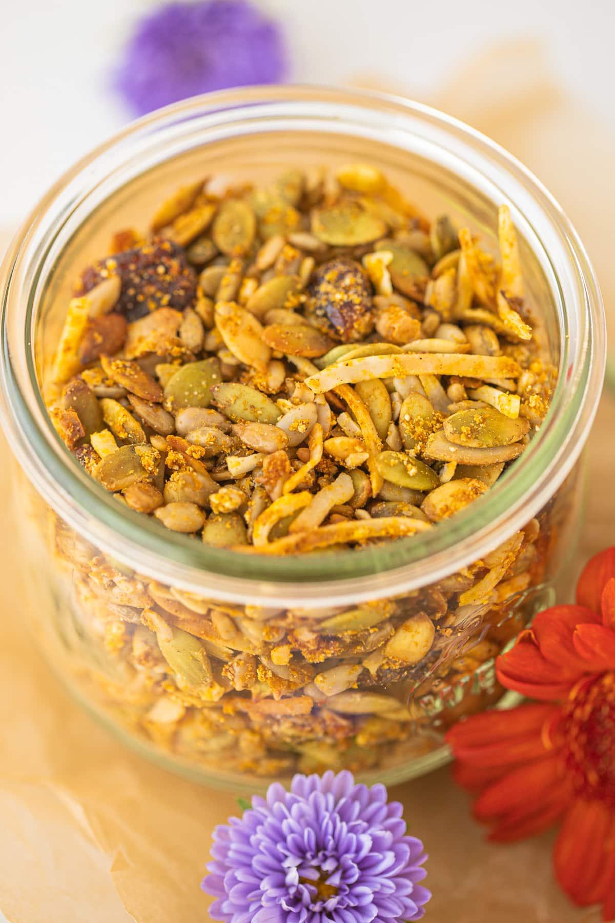 jar of pumpkin spice granola with fresh flowers