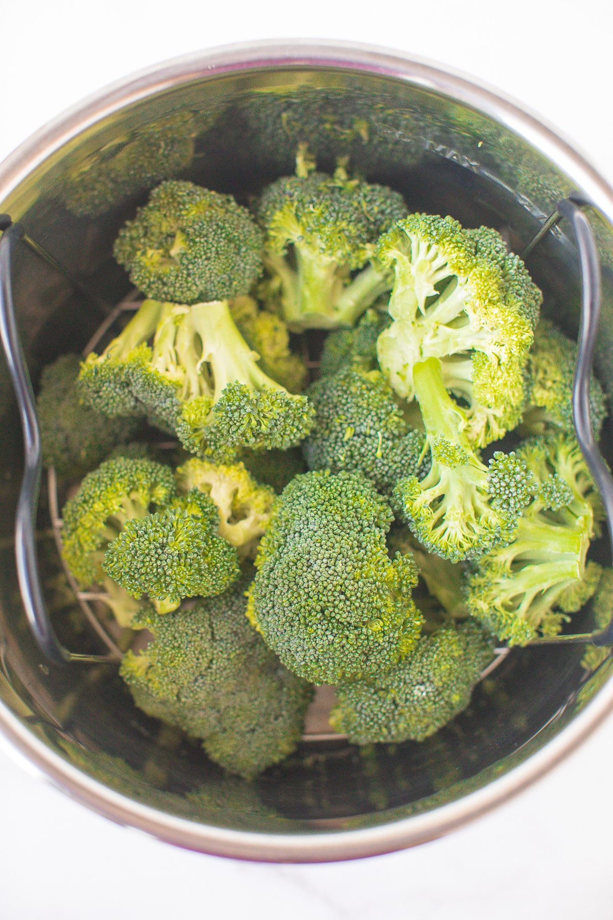 broccoli florets on the trivet in an instant pot