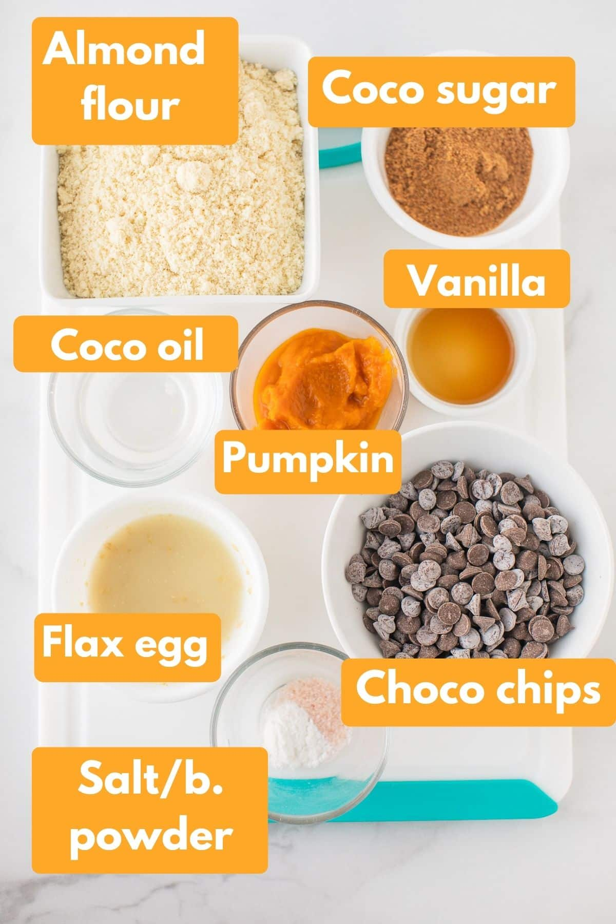 labeled photo with ingredients for vegan pumpkin chocolate chip cookies