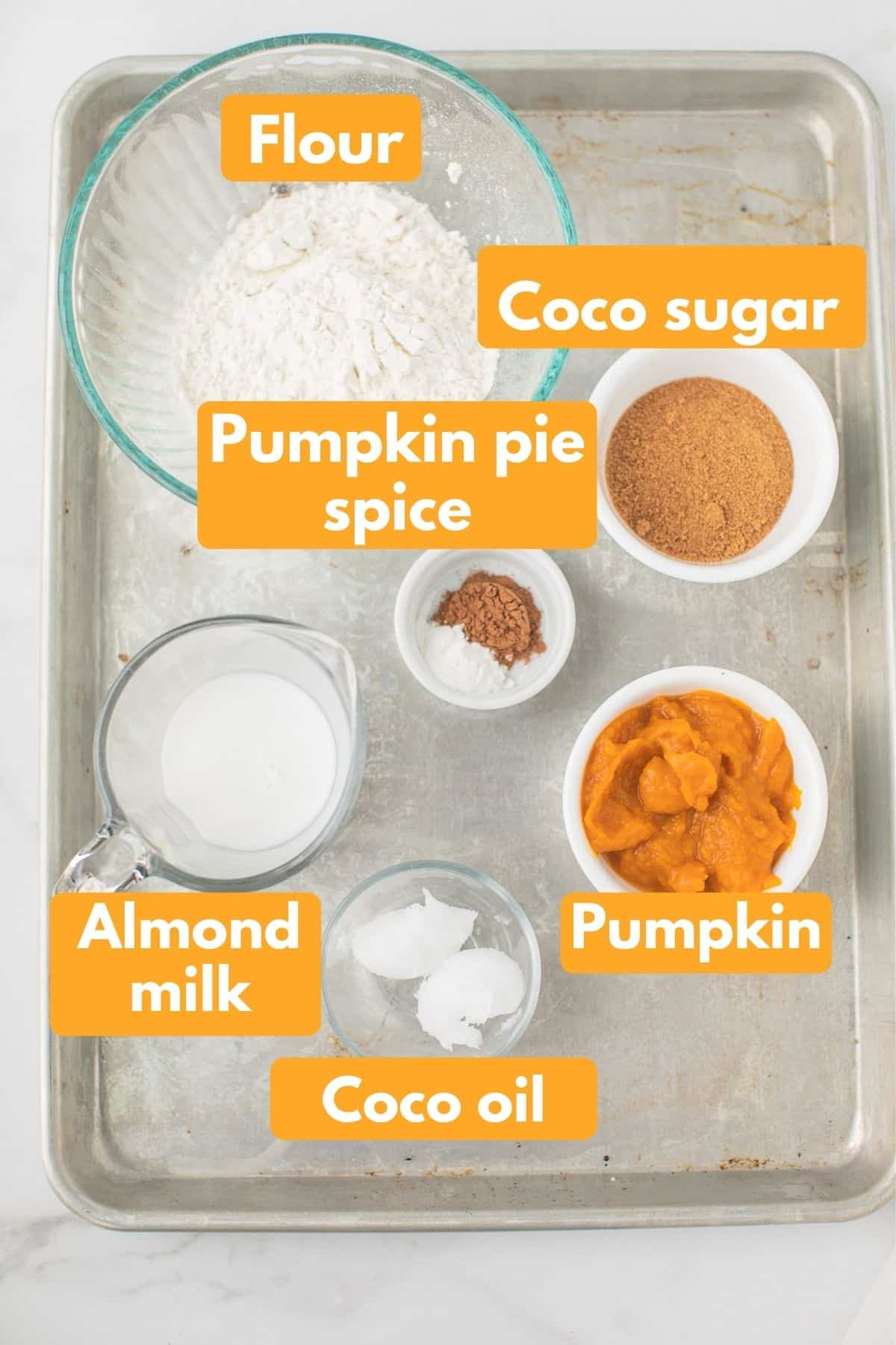 labeled photo with ingredients for pumpkin baked donuts