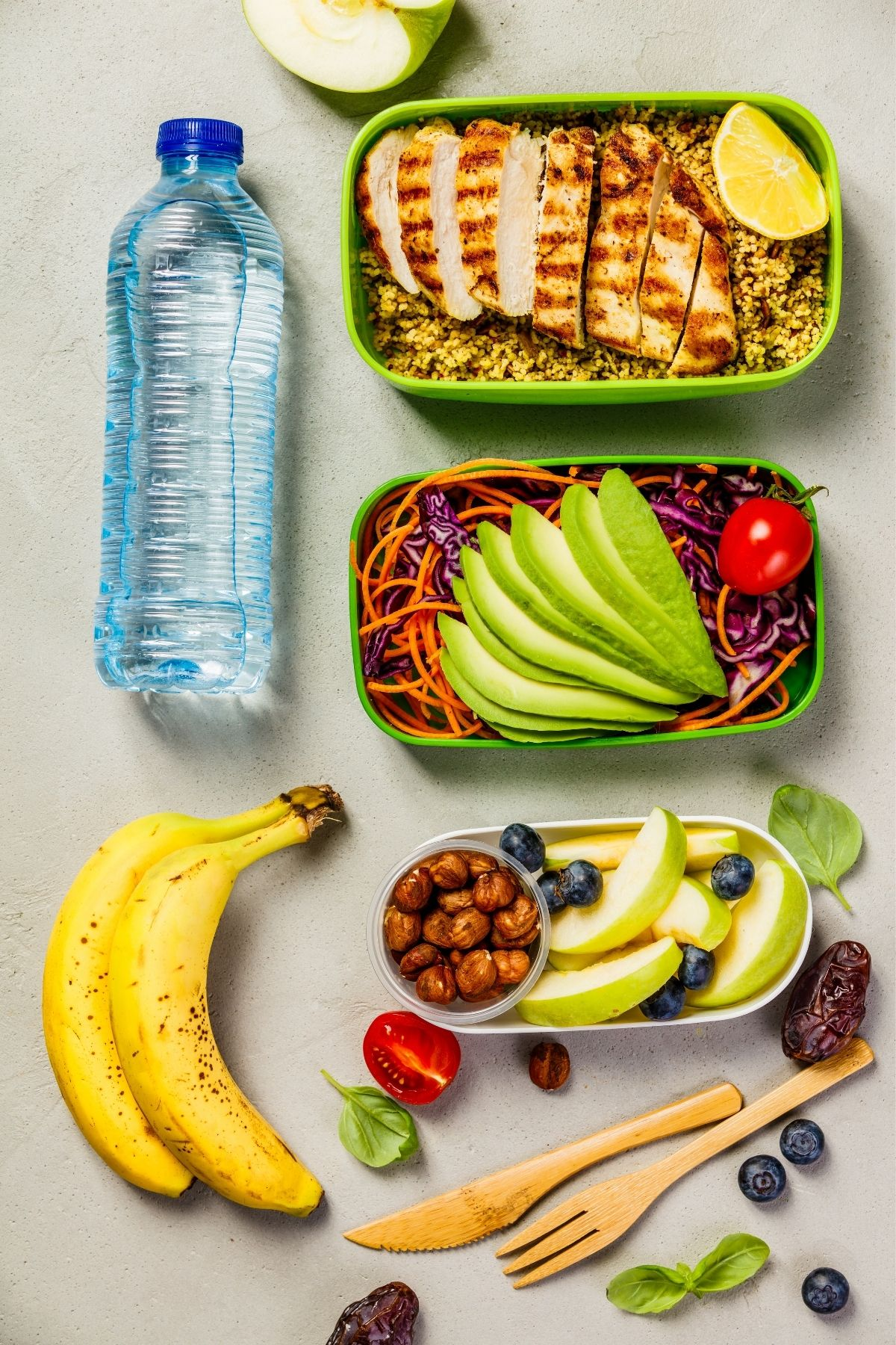meal prepped foods with water and bananas
