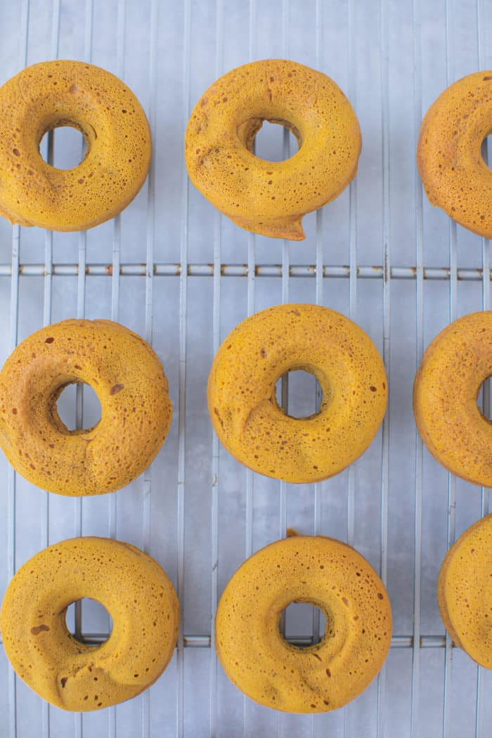baked pumpkin donuts on a cooling rack