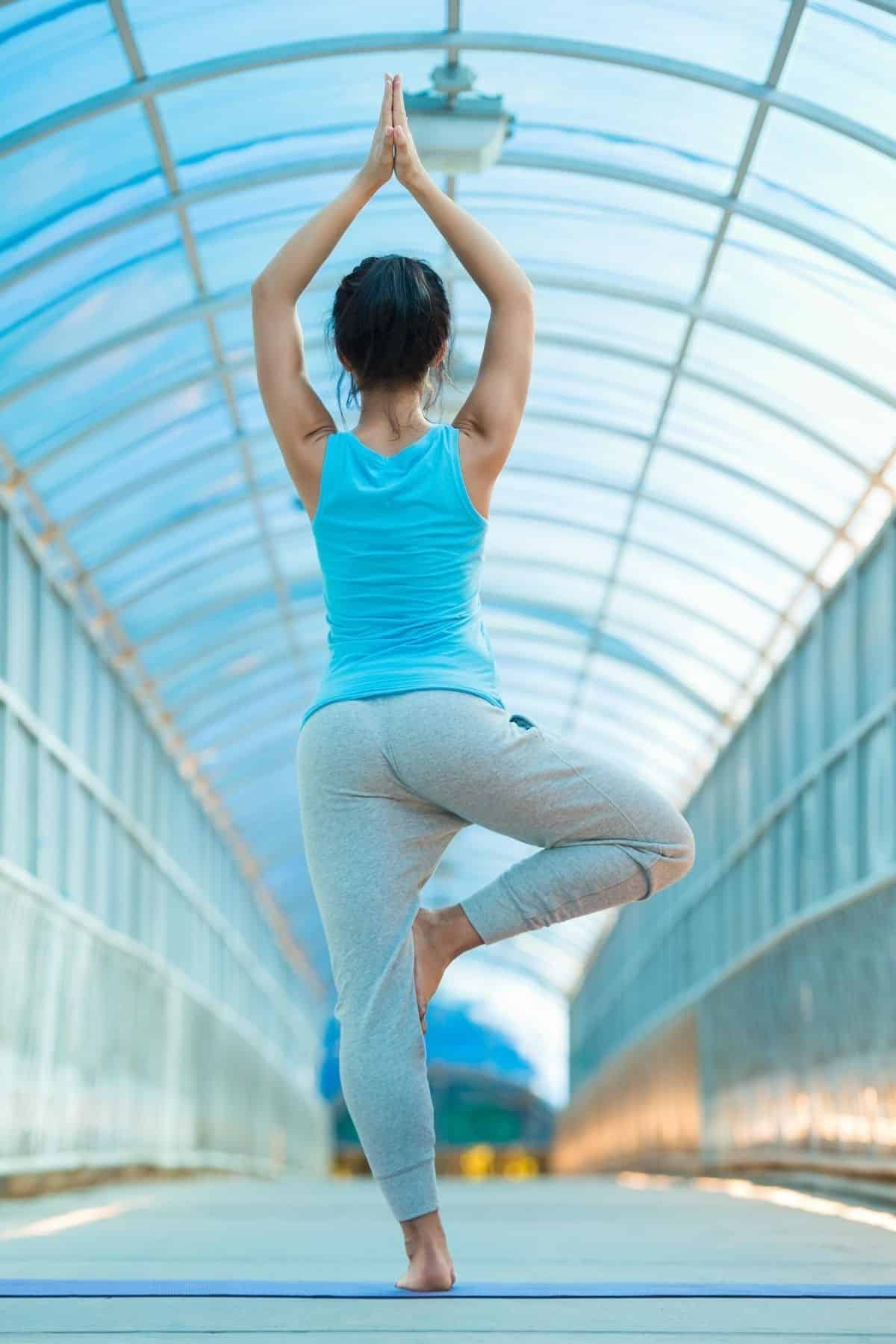 woman in blue doing yoga