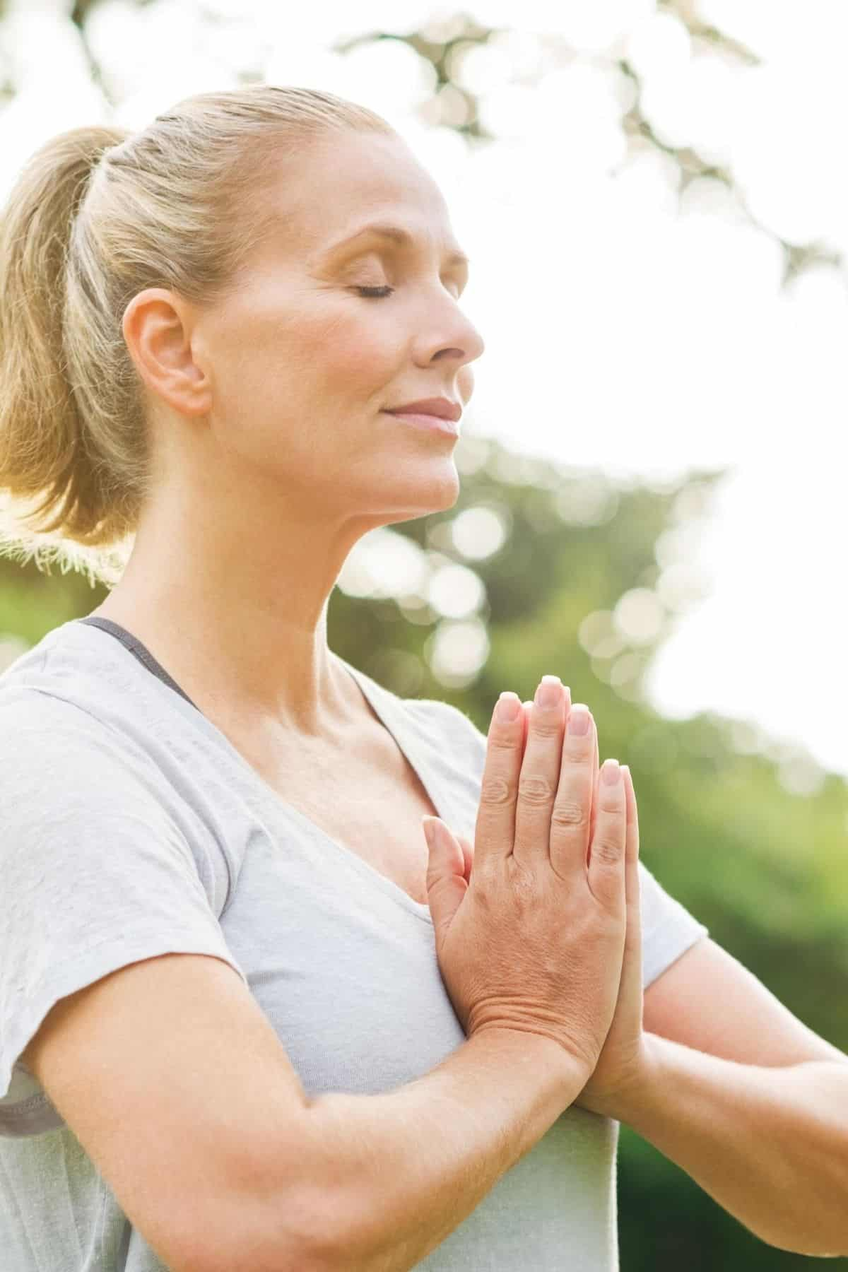 woman outside meditating