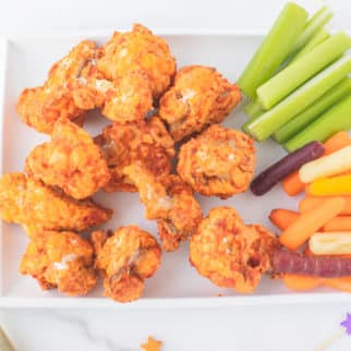 serving tray with crispy air fryer cauliflower wings and other finger foods