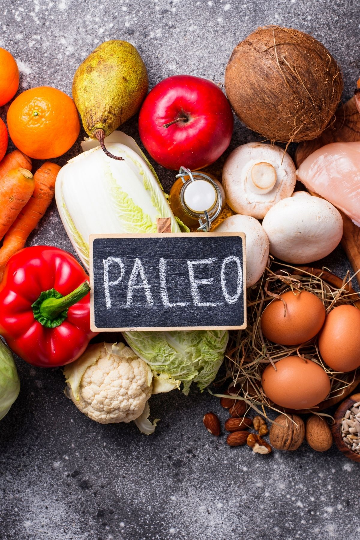 healthy foods on a countertop with a sign that says paleo