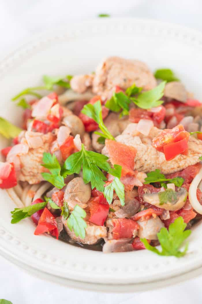 bowl of chicken and tomatoes and peppers
