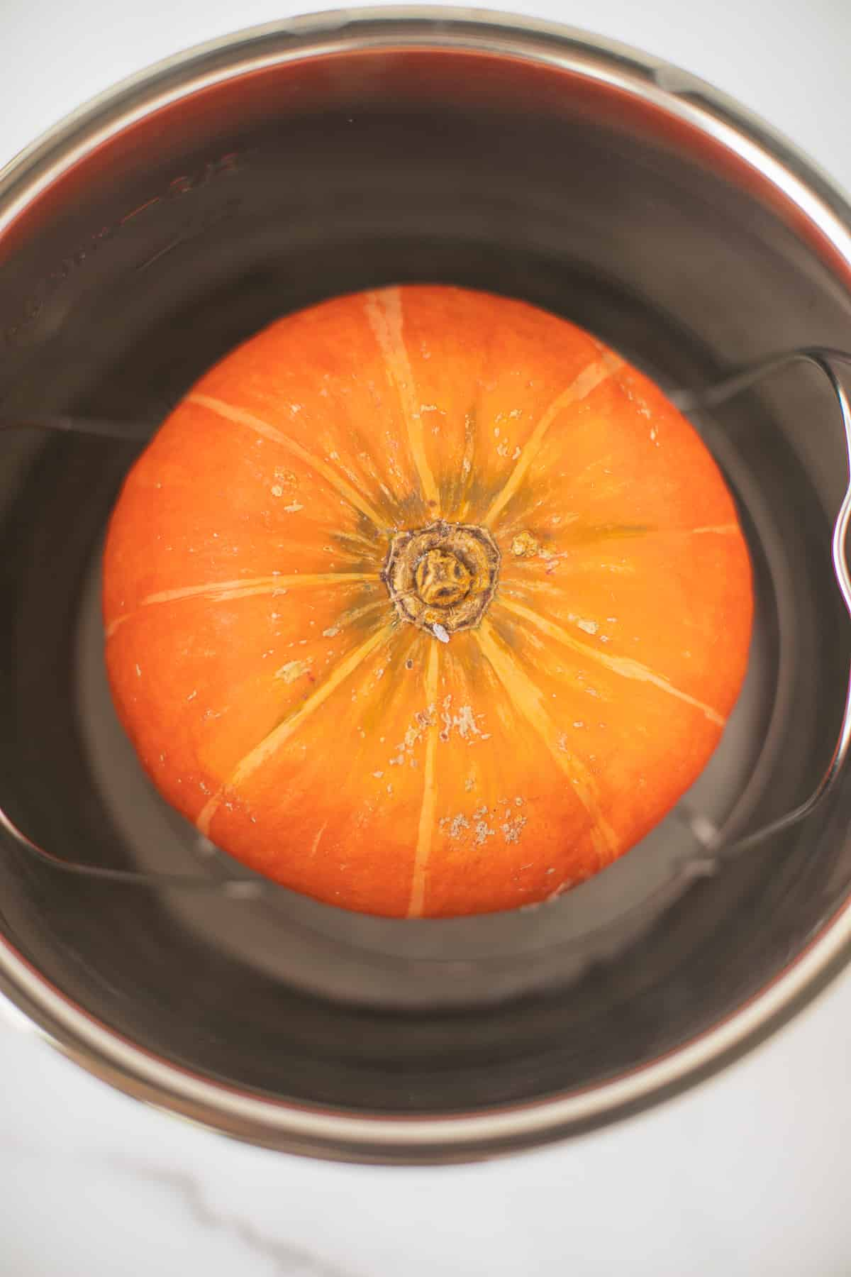 kabocha squash in an instant pot ready to be cooked