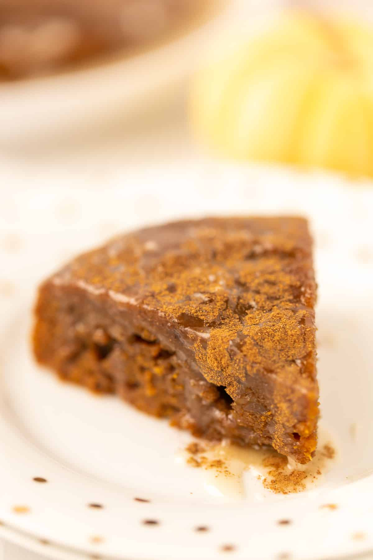 slice of instant pot pumpkin cake on a plate ready to eat